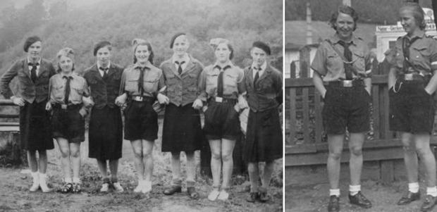 """Noen spøkefulle medlemmer av Bundes Deutscher Mädel og Hitler Jugend stiller opp for fotografen. Joda jøssinger; her er beviset på at det hersker både undertrykking og tyranni på heimefronten i """"nazi-Tykland"""" hvor de ellers så staute karer må gå i taktfull marsj etter alle de lunefulle små pikers muntre påfunn."""